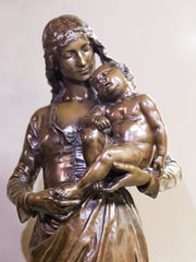 A bronze statue of Mary from the Barbedienne Foundry in Paris circa `1868-1865.