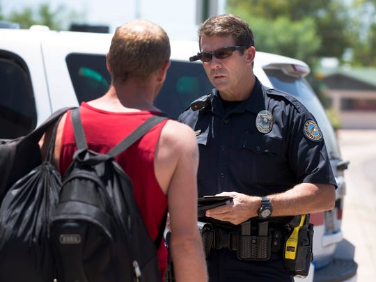 Scottsdale police Officer Don Dittman talks with a