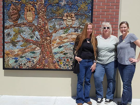 Cory Leick, Jeannett Bair and Lillian Fitzpatrick with the Highlandville students' mosaic.