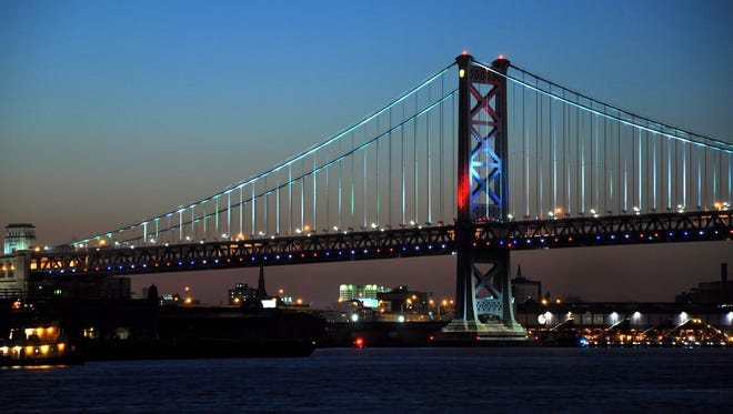 Ben Franklin Bridge will be lit in these patriotic colors lights Thursday  after shining in blue since last week to honor the slain police officers in Dallas and Baton Rouge.