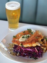 A bone-in Michigan pork chop schnitzel ($25) from Lumen, the flagship restaurant of the newly constructed Beacon Park in downtown Detroit.