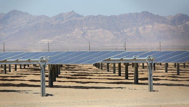 NextEra's 250-megawatt McCoy solar project, just west of Blythe, California, generates electricity on June 22, 2016.