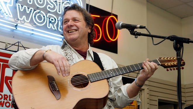 In this Thursday, April 17, 2008 file photo, John Wetton performs with the band Asia at a music store in New York. Singer and bassist John Wetton of the rock group Asia has died. He was 67.