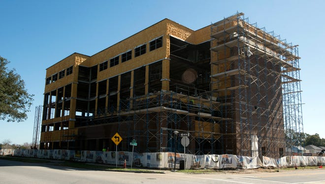 Work continues Monday, Feb. 5, 2018, at the five-story, nearly $10 million Garden Gateway office building at the corner of East Garden and Manresa streets in downtown Pensacola.