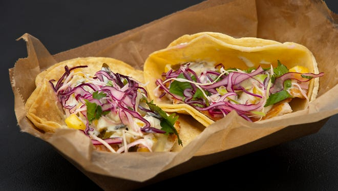The Mayan Street Food's fish tacos are made with grilled Kentucky silver carp, towed with pineapple poblano salsa, jalapeno aioli, purple cabbage and cilantro. Feb. 22, 2018