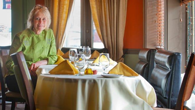 Lilly's Bistro owner and head chef Katherine Cary sits in the restaurant's dining room.Mar. 07, 2018