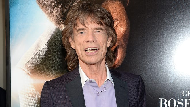 """Mick Jagger at the world premiere of the film """"Get On Up"""" at the Apollo Theater in New York on July 21, 2014. Mick Jagger is behind another James Brown project, the documentary, """"Mr. Dynamite: The Rise of James Brown,"""" which airs Monday, Oct. 27, on HBO."""