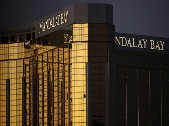 Windows are broken at the Mandalay Bay resort and casino, Tuesday, Oct. 3, 2017, in Las Vegas. Authorities said Stephen Craig Paddock broke the windows and began firing with a cache of weapons, killing dozens and injuring hundreds.