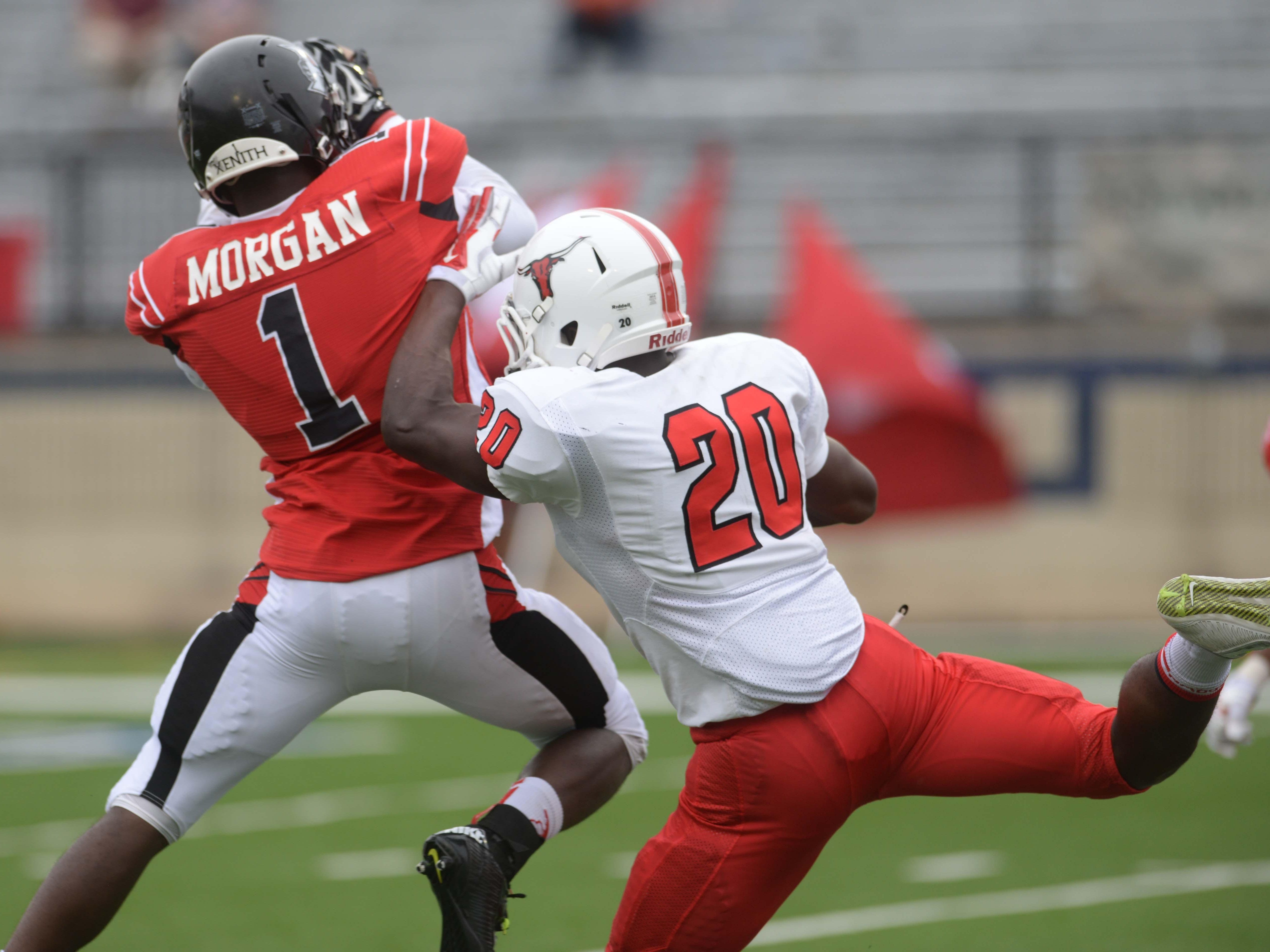 Parkway's C.J. Morgan (1) intercepts a pass from Marshall's John Love (20) during the 2014 Battle on the Border at Independence Stadium.