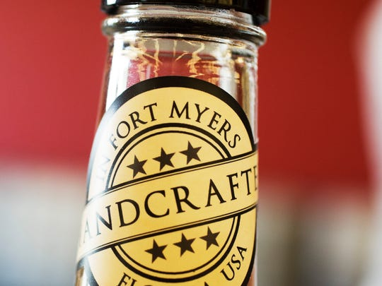Each bottle of alcohol distilled at List Distllery in Fort Myers gets a sticker saying it was hand crafted in Fort Myers.