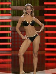 FILE -- Miss Michigan Kirsten Haglund competes in a swimsuit contest during the preliminary competition for the Miss America Pageant at the Planet Hollywood hotel and casino in Las Vegas, Wednesday, Jan. 23, 2008.  (AP Photo/Jae C. Hong)