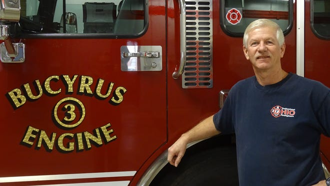Retiring Bucyrus Fire Department Capt. Gordon Grove stands next to Engine 3 one last time after nearly 40 years with the department.