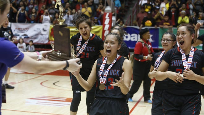From left, Shiprock's Chamika Begaye, Tanisha Begay, Tierra Clichee and Kacy Begay receive the 4A state championship trophy after defeating Hope Christian on Friday at The Pit in Albuquerque.