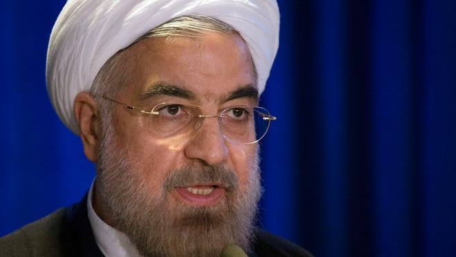 In this Sept. 26, 2013 file photo, Iranian President Hassan Rouhani speaks during a address and discussion hosted by the Asia Society and the Council on Foreign Relations at the Hilton Hotel in midtown Manhattan, in New York.