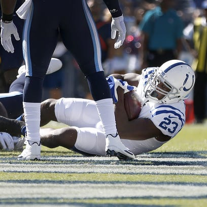 Indianapolis Colts running back Frank Gore (23) falls