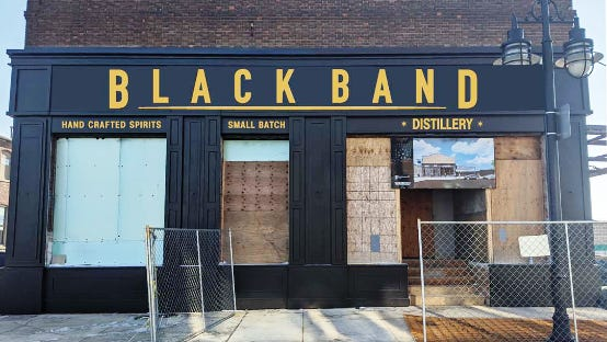 """An artist rendering of the sign planned for above the front doors of Black Band Distillery, expected to open this summer at 1000 SW Adams St. The """"B"""" and """"D"""" in """"Black Band"""" are more than 36 inches tall; the other letter are about 32 inches. Both sets of letters exceed the Warehouse District standard of 18 inches."""
