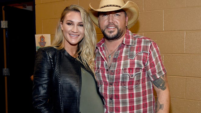 Brittany Kerr and Jason Aldean pose backstage for the Country Rising Benefit Concert at Bridgestone Arena on November 12.