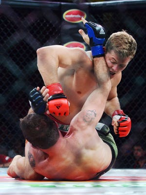 Logan Storley, originally of Webster, takes down Bill Mees during his professional MMA debut Friday night the RFA 29, Resurrection Fighting Alliance fight at the Sanford Pentagon, Aug 21, 2015.