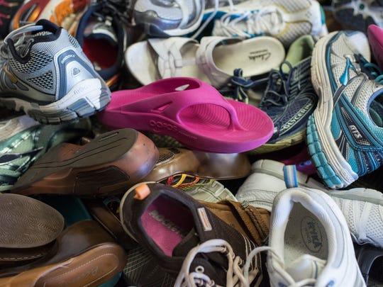 Shoes donated for Chris Cole and Alexandra Bolen at Foot Solutions Estero to take to Haiti to bring the donated used shoes with the charity Soles4Souls.