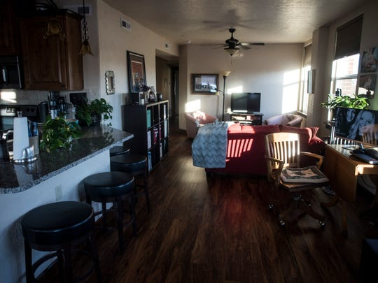 Afternoon light shines through windows in Susan Quinn's home above Crooked Tree Coffee.