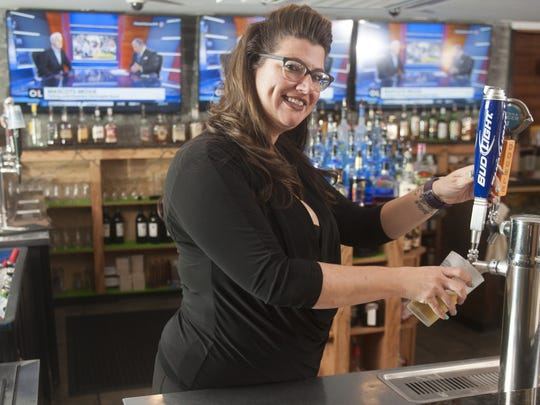 Bartender Khara Ryan pours a beer at The Mansion House in Gloucester City.