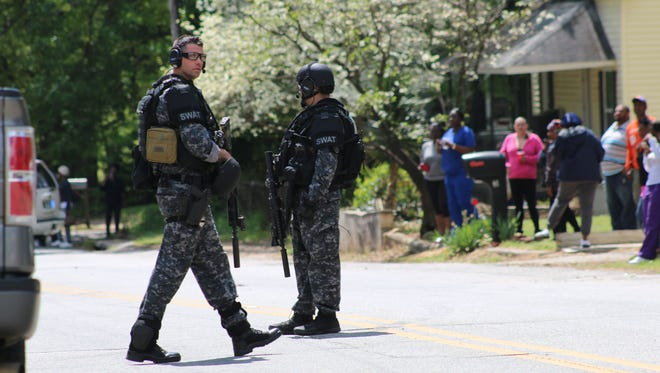 A SWAT team executed a search warrant at a home on Guess Street in Greenville Thursday.