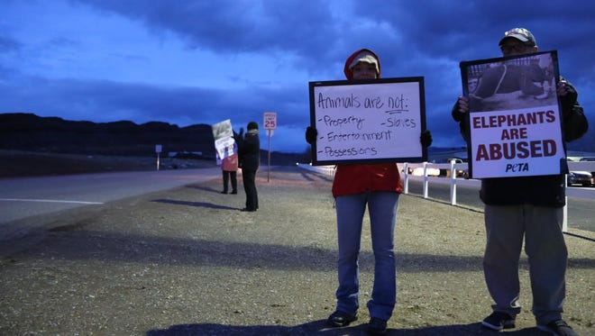 A group of animal rights supporters gathers outside the Jordan World Circus on Jan. 23 to protest cruelty toward exotic animals.