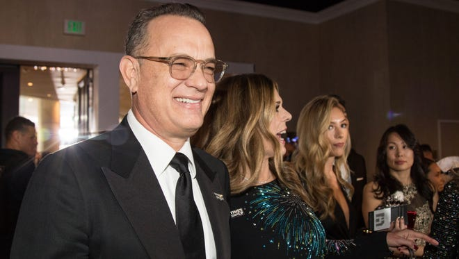 Jan 7, 2018; Beverly Hills, CA, USA; Tom Hanks and Rita Wilson arrive in the International Ballroom for the start of the 75th Golden Globe Awards at the Beverly Hilton. Mandatory Credit: Kyle Grillot-USA TODAY NETWORK (Via OlyDrop)