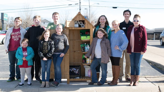T&C Clovers 4-H Club members who worked on the Community Cabin project are: (first row, from left)Jaden Gilbert, Kristen Eddings, Megan Eddings, Morgan Price, Abby Cramer, Alyssa Eddings, (second row)Gage Shaw, Hunter Blum, Joseph May, Caitlyn King andChase Blum.