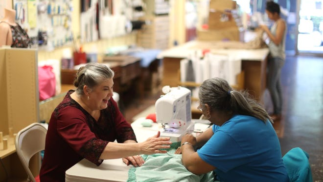 Martha Heath, left, owner of SewNoles, works with student Beverly Roberts at her Midtown shop on Thursday, April 5, 2018. Heath's store helps people learn the art of sewing through classes that start at beginner levels and progress through clothing measuring and creation.