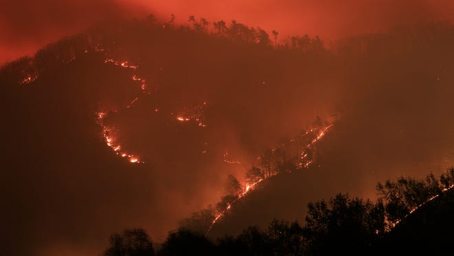A forest fire sparked by a vehicle fire has spread from Rockbridge County into Augusta County. This photograph was taken from Vesuvius.
