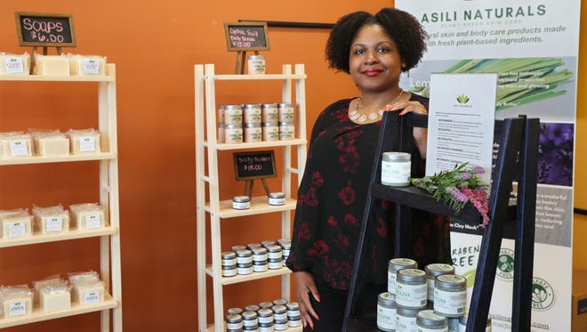Trenise Watson sells Asili Naturals skin and body care products in her space. Asili Naturals is one of two pop-up businesses located in the former Outpost Foods building at 1617 W. North Ave.