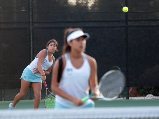 Ranch Mirage doubles players Antonella Mazzotti, left, and Melanie Ramos serve to Glendale during the CIF DIV 5 tennis finals played in Claremont, CA on Friday, November 11, 2017.