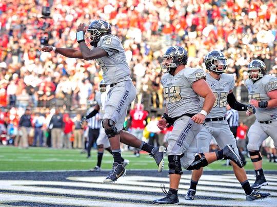 Vanderbilt quarterback Johnny McCrary (2) celebrates