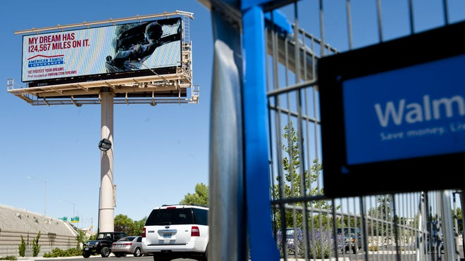 An electronic billboard faces the freeway at the Walmart on Second Street.