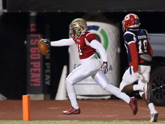 Riverdale's Savion Davis goes in for a touchdown for