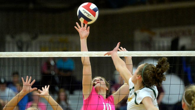 Great Falls High's Hadlee Bleskin,  defends the net against CMR during crosstown last year.