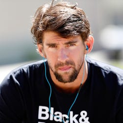 Phelps talks to the media after a practice for the Arena Grand Prix swim meet in April.