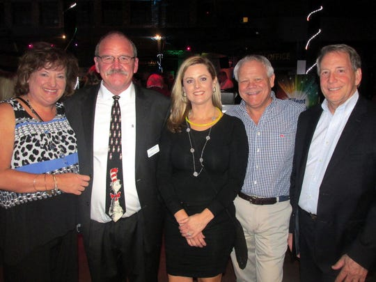 From left, Melanie and head of school John Murphy, event chairs Debbie and Barry Marshall and auctioneer Jeff Morris were at Bodine Bash.