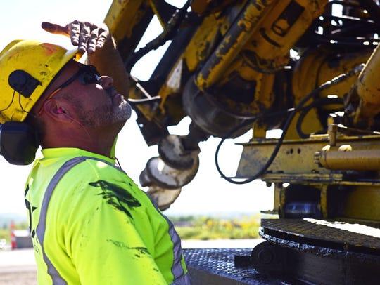 Angel Navarrete, a laborer for BX Construction, attempts
