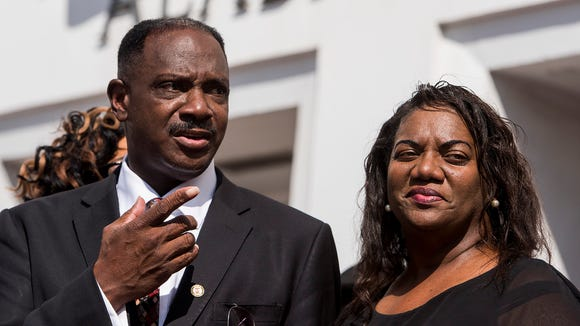 Montgomery City Councilman David Burkette, with his wife Linda Burkette, announces his race for the state Senate seat recently vacated by former Sen. Quinton Ross, on the steps of the Alabama Statehouse in Montgomery, Ala. on Tuesday October 10, 2017.