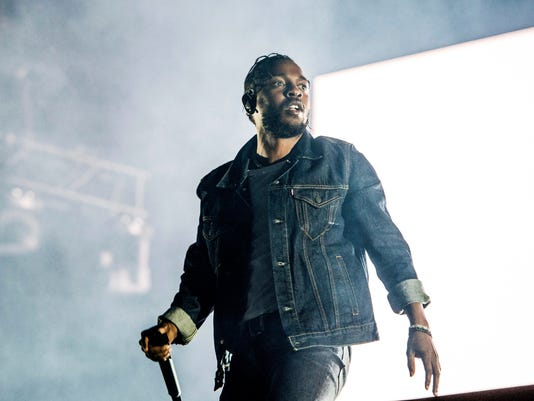 FILE - In this July 7, 2017 file photo, Kendrick Lamar performs during the Festival d'ete de Quebec on Friday, July 7, 2017, in Quebec City, Canada.  Lamar is set to perform at the MTV Video Music Awards this month. MTV said Thursday, Aug. 10,  that Lamar will take the stage at the Aug. 27 event at the Forum in Inglewood, Calif. Lamar is nominated for eight awards. (Photo by Amy Harris/Invision/AP)