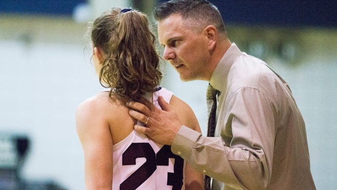 St. Thomas More coach  Stephen Strojny  talks to Meredyth Howard during the Lady Cougars' regional win over Bossier.