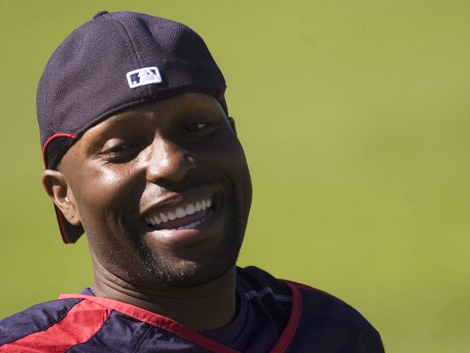 Torii Hunter of the Minnesota Twins stretches after