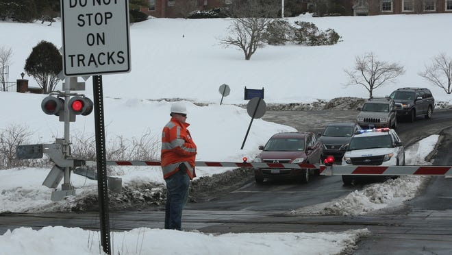 Metro-North Railroad employees test the crossing signals and safety arms at the Roaring Brook Road railroad crossing in Chappaqua, March 7, 2015. Work will begin next week to add new signs and pavement markings to warn motorists about the crossing.