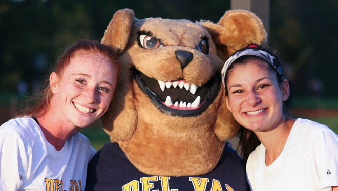 Del Val High School's mascot helps boost school spirit at the Sept. 22 pep rally. With Tuffy the Terrier are Del Val field hockey players Sarah Babcock (left) and Jillian Ethem.
