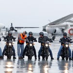 IMAGE DISTRIBUTED FOR HARLEY-DAVIDSON - The scene from above the flight deck of the USS Yorktown - six veterans and active-duty military ride the H-D Street 500 as Harley-Davidson announced it is offering current and former U.S. military free Riding Academy motorcycle training on Wednesday, May 6, 2015 in Mt. Pleasant, S.C.