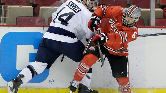 Penn State senior Tommy Olczyk (14) has seen the Penn State hockey program rapidly develop during his five years at State College.