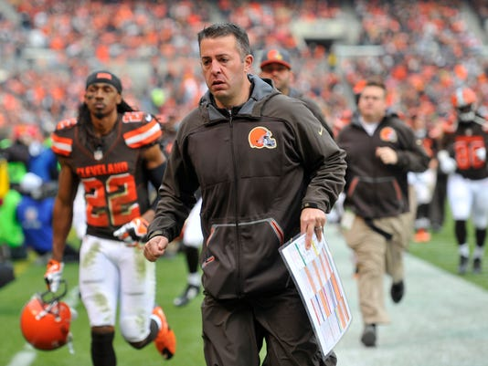 FILE - In this Dec. 6, 2015, file photo, Cleveland Browns offensive coordinator John DeFilippo runs off the field at halftime during the team's NFL football game against the Cincinnati Bengals in Cleveland. A person familiar with the decision says DeFilippo is no longer with the team. DeFilippo had two more seasons left on his contract, but he will not be retained by new coach Hue Jackson, the person told the Associated Press on condition of anonymity Saturday because the move has not been announced by the team. (AP Photo/David Richard, File)