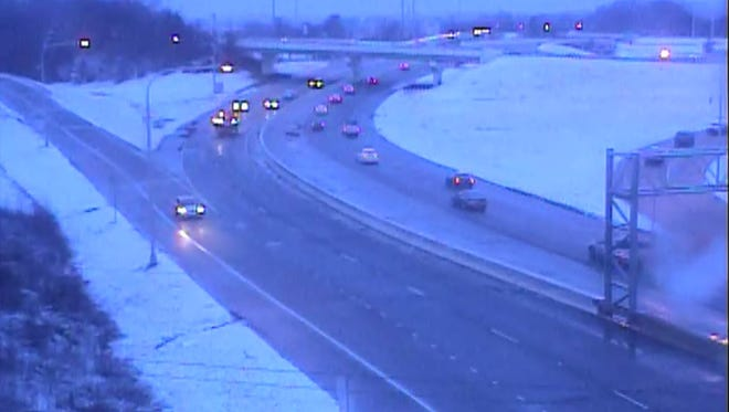 In this image captured from a Delaware Department of Transportation traffic camera, motorists drive on Del. 273 at Chapman Road Friday morning. Overnight rain and snow may slow the morning commute.